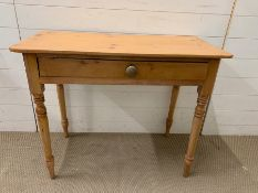 A pine console table with drawers to centre (H73cm W90cm D42cm)