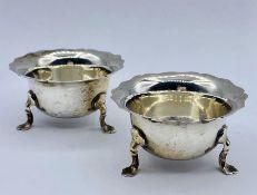 A pair of silver salts on three feet, London hallmark, makers mark RP
