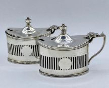 A pair of silver salts with blue glass liners by Haseler Brothers (Edward John Haseler & Noble