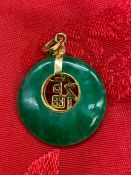 An 18ct gold and Jade pendant