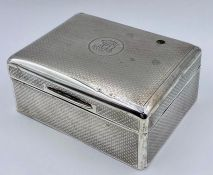 A silver cigarette box, hallmarked London 1919 by CLS