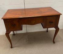 An Art Deco walnut desk with two side drawers (109 cm w x 54 cm d x 76cm h)