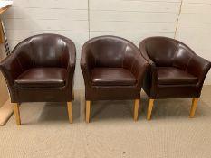 Three brown leather club or tub chairs (W60m x D60cm x H82cm)