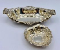 Two decorative silver bowls, one in a heart shape, various hallmarks. (Total weight 55g)