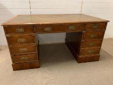 A leather top campaign style desk (H74cm W154cm D87cm)