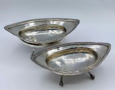 Two silver bowls on ball and claw feet, continental. 177g (15cm long)