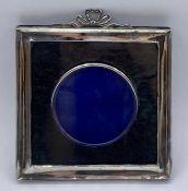 A silver picture frame (14.5cm sq) by Henry Matthews hallmarked Birmingham 1905.