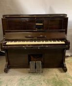 An upright self playing piano by J Hopkins and Sons Grimsby with a selection of music rolls (