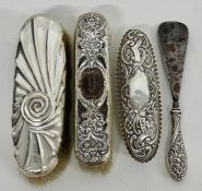 Four assorted silver Ladies dressing table items to include two brushes, a silver topped cut glass