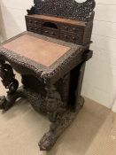 An Anglo-Indian carved Davenport. Writing surface with enclosing drawers, flanked each side with