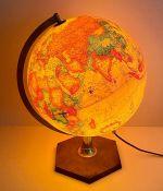 An Illuminated world globe on stand