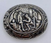 A silver snuff box with tavern decoration, hallmarked for 1900. (7cm long)