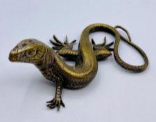 A Brass figure of a lizard