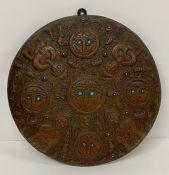 A small decorative shield in a Mesopotamia style