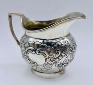 A silver milk jug, hallmarked for 1919 and by Edward Barnard & Sons Ltd Total weight 160g