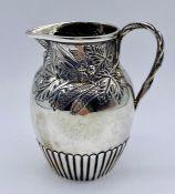 A silver milk jug, hallmarked for Birmingham 1862, by Simeon Greenberg (105g)