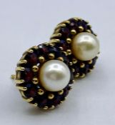 A Pair of 18ct gold earrings with central pearl and ruby style stones.(5.3g)