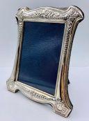 A silver photo frame, hallmarked for Sheffield 1998 by Carr's of Sheffield Ltd (18cm x 15cm)