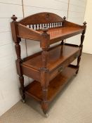 A mahogany serving table on wheels with drawers to front (H120cm W116cm D45cm)
