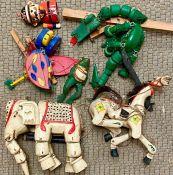 A selection of wooden vintage puppets AF