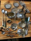 An interesting selection of silver plated items including candlesticks, serving spoons, tea caddy's,