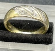 A gold ring marked 585 and with a total weight of 4.9g