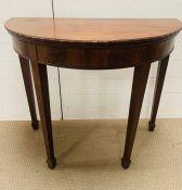An 19th century mahogany Demi Lune fold over card table (78cm x 92cm)