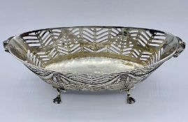 A silver pierced bowl on four claw feet, (total weight 200g) by William Moering, London 1896,
