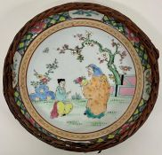 An oriental themed painted bowl, with a wicker decoration to edge AF
