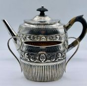 A silver teapot and sugar bowl, hallmarked London 1881, by William Hutton & Sons (Total weight