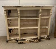 A late Victorian painted oak breakfront open bookcase (H110cm W138cm D39cm)