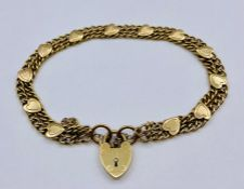 A 9ct gold bracelet with heart shaped fastener and safety chain (Total weight 10.6g)