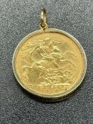 A 1910 gold sovereign coin in a 9ct gold mount (The mount weighs 1g)