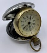A Dalvey St Elmo travel clock with a stainless steel case