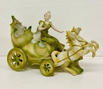 A fairy-tale themed figure of a girl and a carriage AF