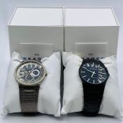 Two watches by Skagen 694XLTMXB and the 694XLTM both with original boxes.