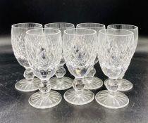 A set of seven cut glass sherry glasses