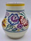 A Poole pottery England pot, yellow and purple themed