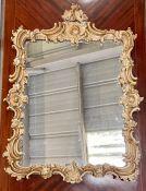A decorative framed mirror AF