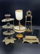 A selection of brass items including a onyx and gilt metal cigarette holder and ashtray
