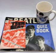 A small selection of Beatles memorabilia to include The Beatles Quiz book, Teen Beat No 5 and The