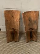 Two outside terracotta candle wall hangings
