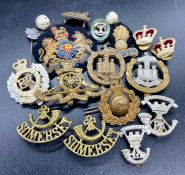 A collection of military cap badges and insignia.