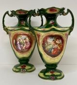 A pair of two handled urn vases