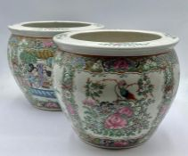 A pair of two small Chinese fish bowls