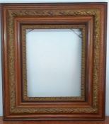 An English frame parcel gilt with floral decorations (72x64.5 cm total/ 41.4x34.5 cm interior)