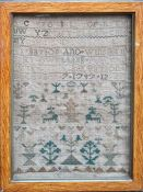An 18th century Sampler worked in silk on linen ground, in a variety of stitches. Alphabets A-Z in