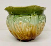 A green ceramic jardinière.
