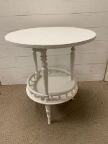 A small painted occasional table with galleried shelf Diameter 54cm x 65cm High