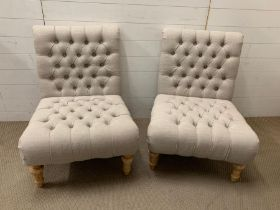 A Pair of linen button back and seat low chairs (Height 85 cm, width 59cm and seat height 40cm)